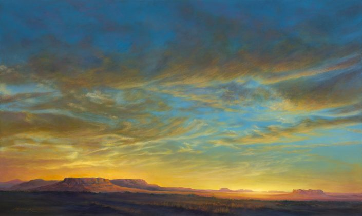 Luminescent Southwest sunset sky, mesas in foreground