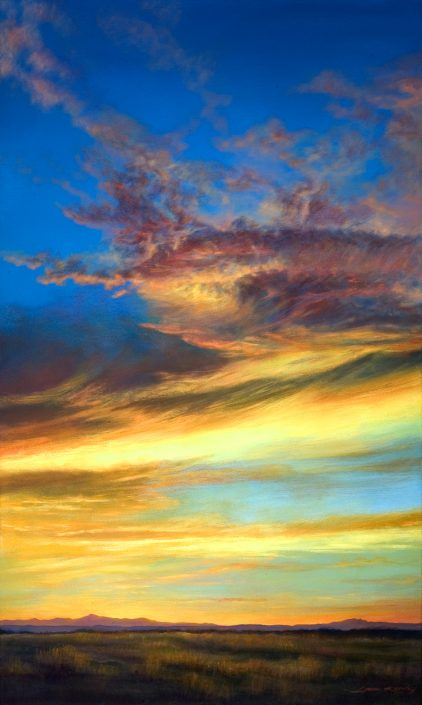 Brilliant vertical Southwest sunset, minimal desert foreground